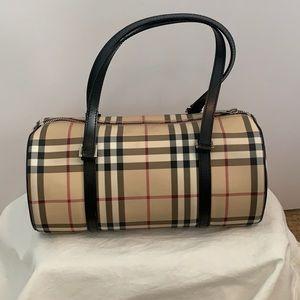 Burberry barrel bag.